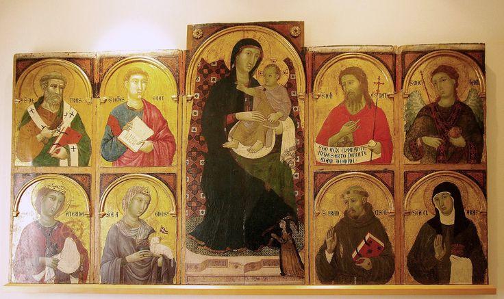 https://upload.wikimedia.org/wikipedia/commons/a/aa/Memmo_di_Filippuccio._The_Virgin_and_Child_with_the_Donor%2C_a_Poor_Clare_Nun%2C_and_Saints._ca._1310-17%2C_San_Gimignano%2C_Pinacoteca.jpg Memmo di Filippuccio. The Virgin and Child with the Donor, a Poor Clare Nun, and Saints. ca. 1310-17, San Gimignano, Pinacoteca.