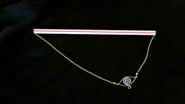 To avoid tangling, thread a straw with your delicate necklaces.
