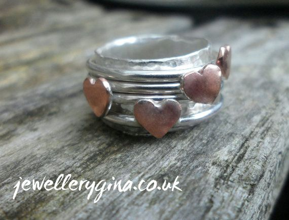 Hand Hammered Spinning Ring with 4 Copper Heart's on Etsy, £55.00