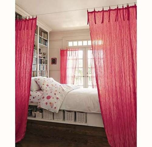 Love the wall of bookshelves and the separation the curtain provides