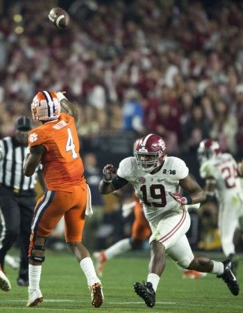 Alabama linebacker Reggie Ragland (19) pressures Clemson quarterback Deshaun Watson (4) during the second half of Alabama's College Football Playoff National Championship football game with Clemson, Monday, Jan. 11, 2016, at University of Phoenix Stadium in Glendale, Ariz