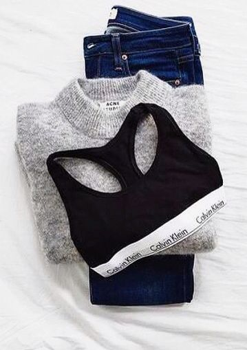 Comfort clothes: Calvin Klein sports bra, big sweater, + high waisted jeans. #style.