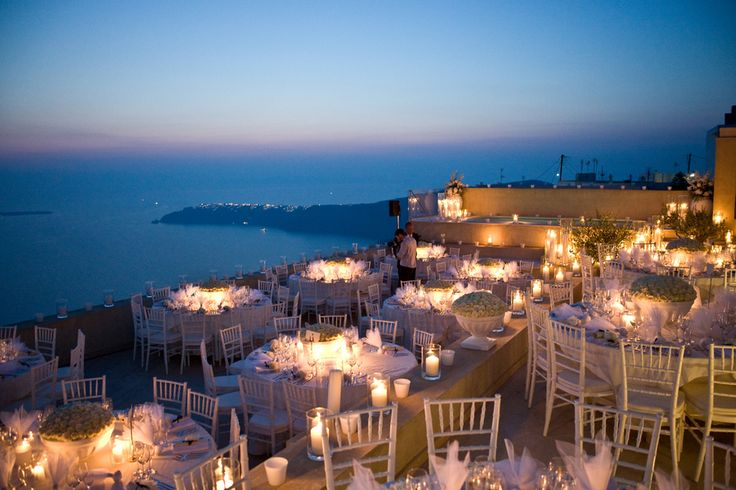 This is EXACTLY how i'd like my reception area to look if I get married in Santorini :) - so romantic with a gorgeous view of the sea <3