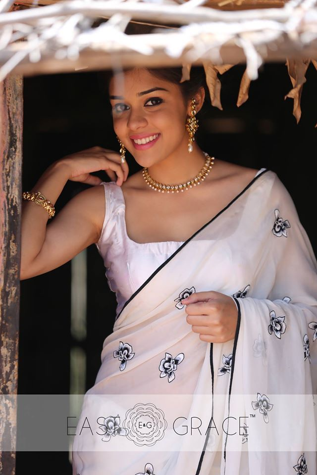 Presenting the royal Iris on a milky white, ethereal pure chiffon saree with pallu adorned with white and black Iris flowers, exquisitely handcrafted with silk shading. Here's a six yards of your statement black-and-white color palette, fresh and welcoming, off the beaten path. Please visit www.eastandgrace.com and subscribe to our newsletter to buy! #saree #lehenga #indowestern #eastandgrace #love #indianwedding #onlineshopping #indianfashion #pastel #chiffon #emroidery #nature #white