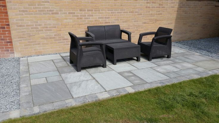 Grey Sandstone from Marshalls. Supplied and fitted by Mango Paving & Landscaping Ltd. Makes a wonderful seating area for all to enjoy.