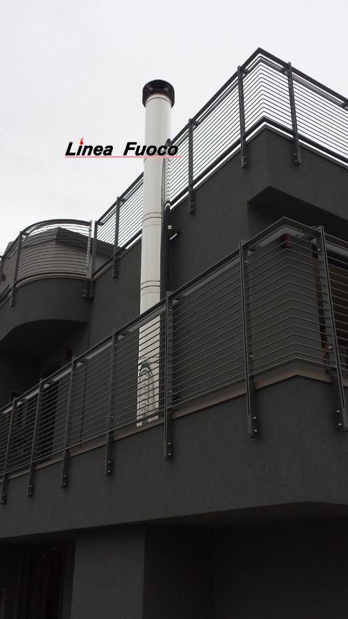 Camino #lineafuoco realizzato con elementi in #doppiaparete diam. 300 mm in acciaio inox