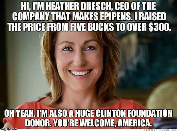 Her name is Heather Bresch.  Her father is Senator Joe Manchin  (Democrat).