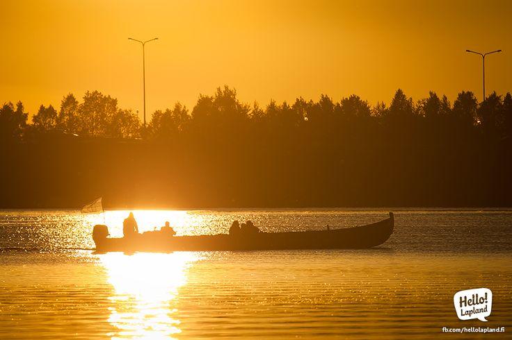 A safari boat during sunset, around 11 PM in Rovaniemi.