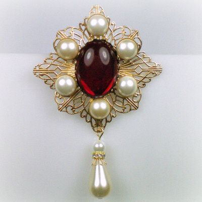 Gemstone brooch of Catherine Howard. Lovestruck with his very young bride, Henry VIII spent more money on jewels and gifts for her than on any of his other wives.