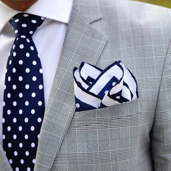 Coordinating polka dot tie and pocket square in navy and white. Keep Your Fold all day - https://www.amazon.co.uk/dp/B01MTQU0EX