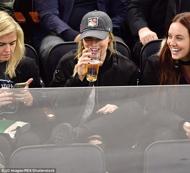 Ice, ice baby: Margot Robbie is taking to her new life in US like a duck to water as she was spotted enjoying a NHL ice hockey game between New York Rangers versus Ottawa Senators on Sunday