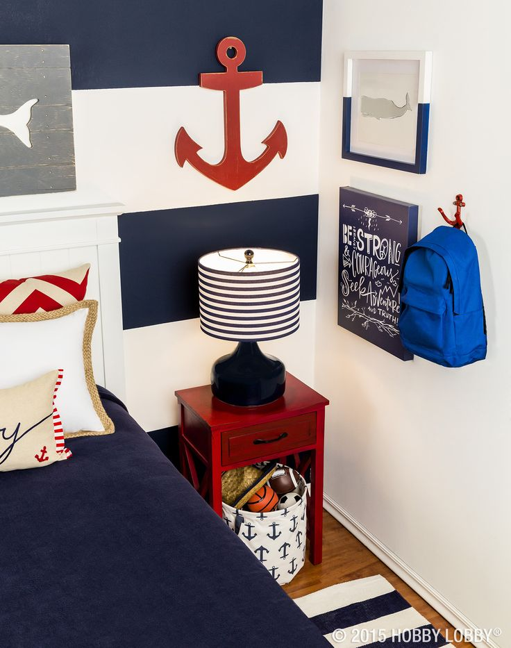 Complete with blue, white and pops of red, this nautical-themed room is sure to please your favorite little sailor!