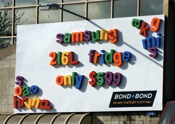 giant fridge magnet billboard. love this, so clever