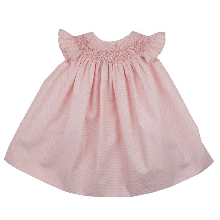 Roze met wit gestippeld zomerjurkje met smockwerk van DBB Ideas. Het jurkje heeft korte ruche mouwtjes