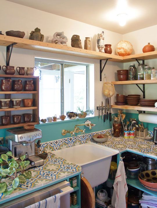 Open shelving, colorful tiles, great window placement, natural wood