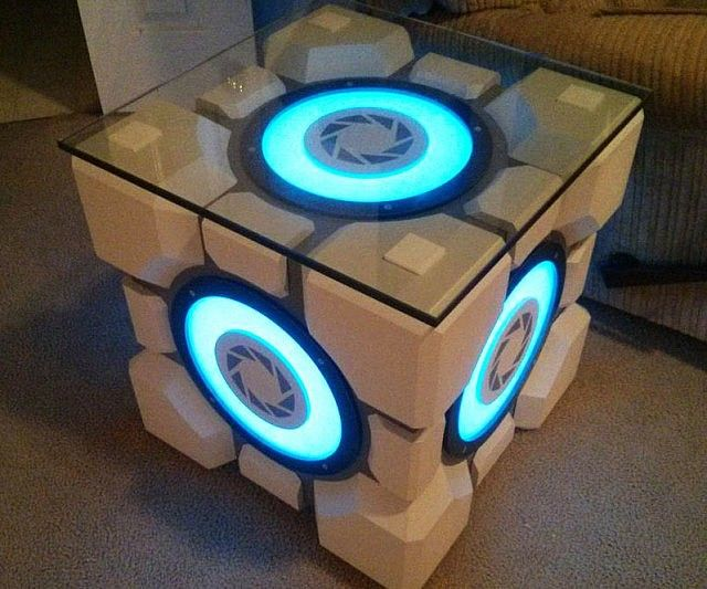 "Give your living room a quirky touch by building your very own weighted Portal storage cube table following [link to=""http://orig11.deviantart.net/10ce/f/2015/007/f/a/mgb18996_by_fetchbeer-d8d0qcx.pdf"" say=""these detailed instructions here""]. Designed by reddit user fetchbeer, this incredible light up table is perfect for diehard Portal fans."