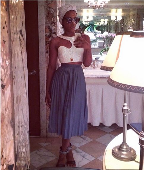 Dawn Richard, who selfied her Sunday while wearing an asymmetric crop top, a turban, a long periwinkle pleated skirt and sandals.
