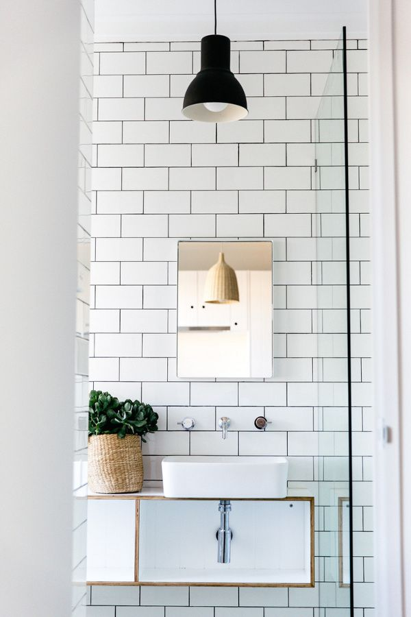 white subway tiles and black hanging pendant light