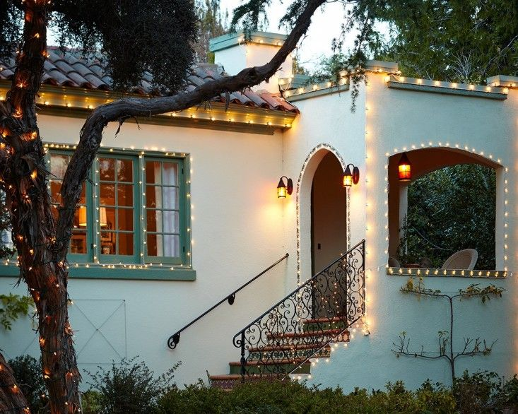 It gets dark around here before 5 pm in December, so even if Christmas didn't exist I still would rig up some twinkly outdoor lights to make coming home feel like a winter holiday. Whether you want to get fancy with different size bulbs or stay simple with a single strand around the doorway, here are ten of my favorite kinds of outdoor string lights:
