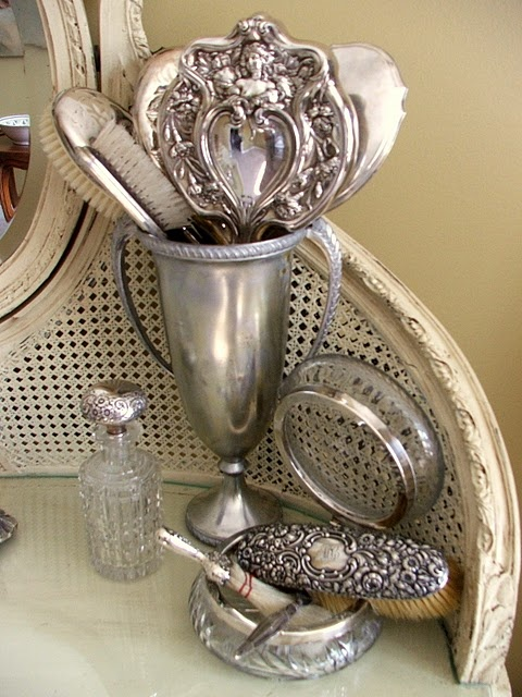 Nicole wakes in the Bradshaw home to find a vanity set for her complete with silver brush and mirror like these Silver vanity accessories