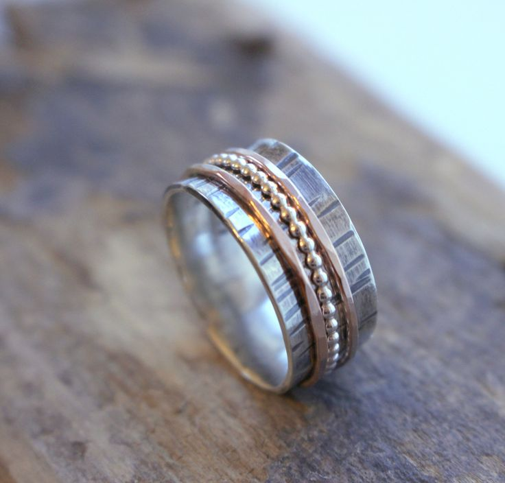 A personal favorite from my Etsy shop https://www.etsy.com/listing/203785453/rose-gold-sterling-spinner-ring-fiddle