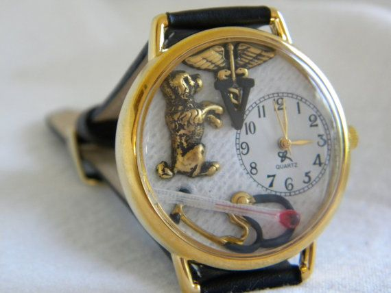 This veterinarian watch is much like the one with the cats but has a dog inside. It also has a gauze background with a V on a caduceus,