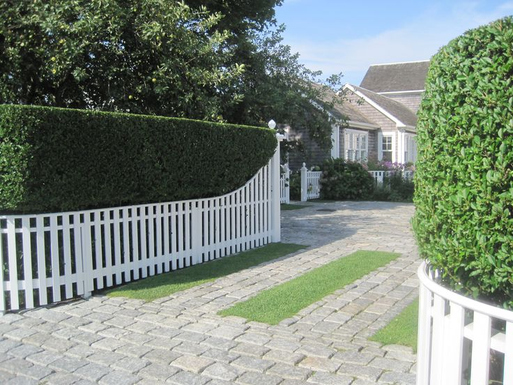 Nantucket Belgian block driveway with clipped privet hedge for gus area