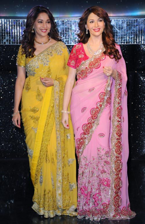 Madhuri Dixit in her canary coloured sari at the unveiling of her wax statue was eye-popping to say the least. #Bollywood #Fashion