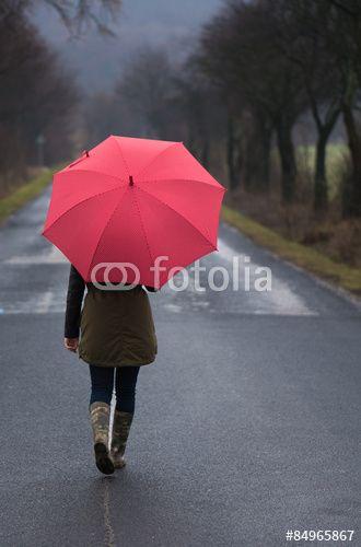 Rainy day woman holding red umbrella