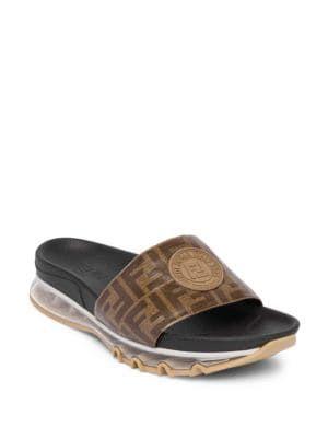 6571392ac92 FENDI Logo Print Rubber Slides.  fendi  shoes