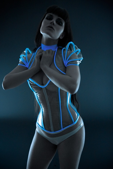 Electroluminescent Wire (EL Wire) built-in to a corset of sorts. Super awesome…