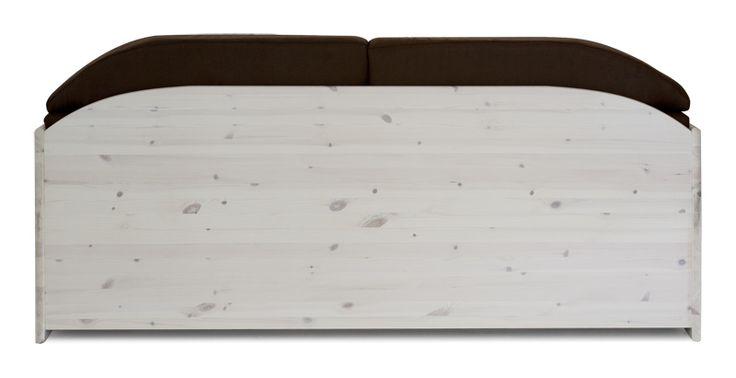 Divano rustico in legno massello di pino di Svezia, proposto in finitura bianco trasparenza. www.arredamentirustici.it