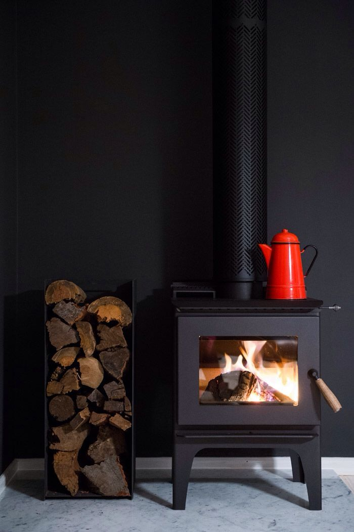Like the wood storage. SLC 160R wood heater by Aranbe Heat. http://www.aranbeheat.com/SLC160R.html