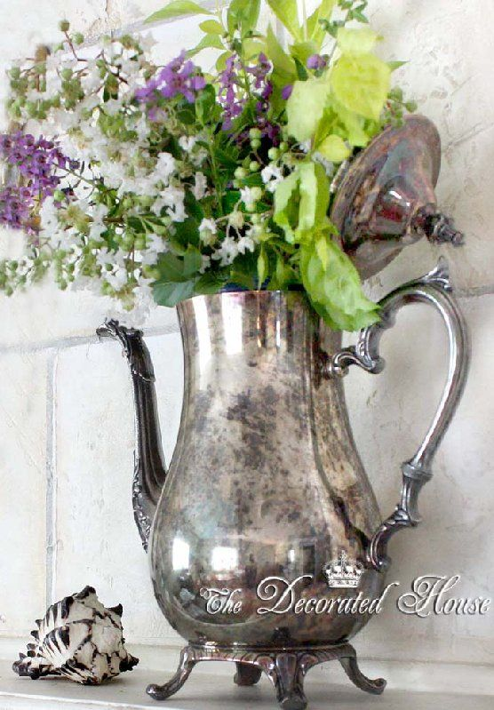 Vintage tarnished silver pot with summer flowers & wonderful little sea shell. Summer mantel.