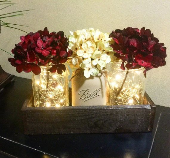 This listing is for a stunning and warm toned Rustic Mason Jar Centerpiece with mini fairy lights. This is sure to add an elegant twist to any