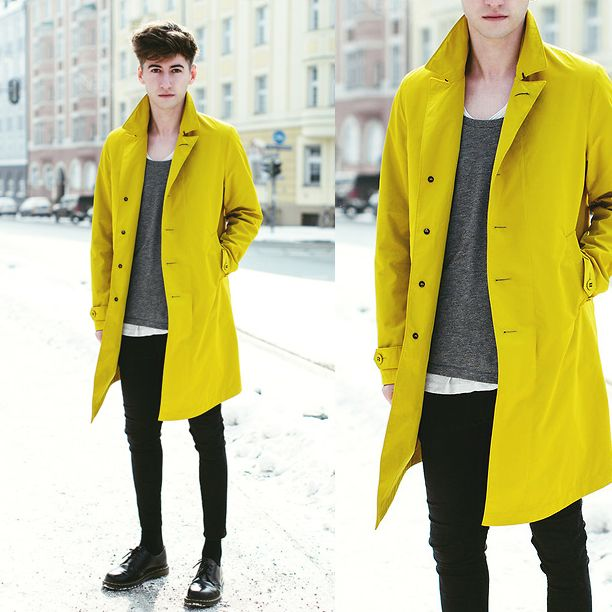 The yellow coat may be too bold for some men.  It works here because the base pieces are dark and simple.