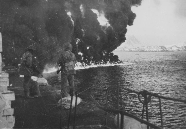 The British commandos watch the burning fuel from the pier of the captured Norwegian city of Stamsund during the raid on the Lofoten Islands (Operation Claymore) - the successful landing of some 600 British commandos on the Lofoten Islands to destroy fuel depots. During the operation, 10 German ships were sunk and 228 captured.