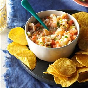 """Lime-Marinated Shrimp Salad Recipe -Ceviche is a seafood dish of raw fish marinated in citrus juice, which """"cooks"""" the fish without heat. This version starts with cooked shrimp and adds tomatoes, cucumbers and serrano peppers. —Adan Franco, Milwaukee, Wisconsin"""