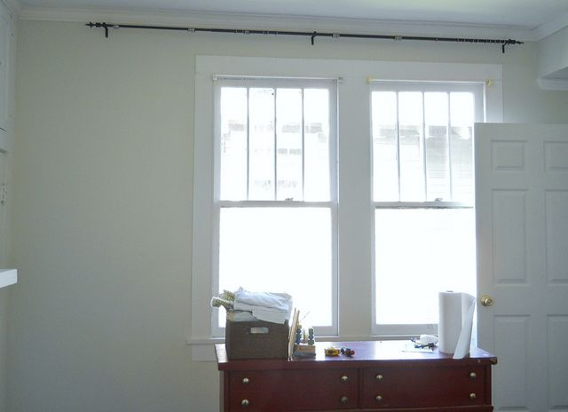 How to Disguise an Off-Center Window with Curtains- girls' room. genius.