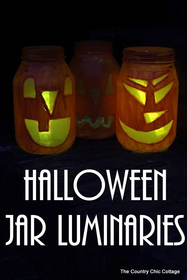 Halloween Jar Luminaries -- light up the night this Halloween with these quick and easy to make mason jar luminaries!