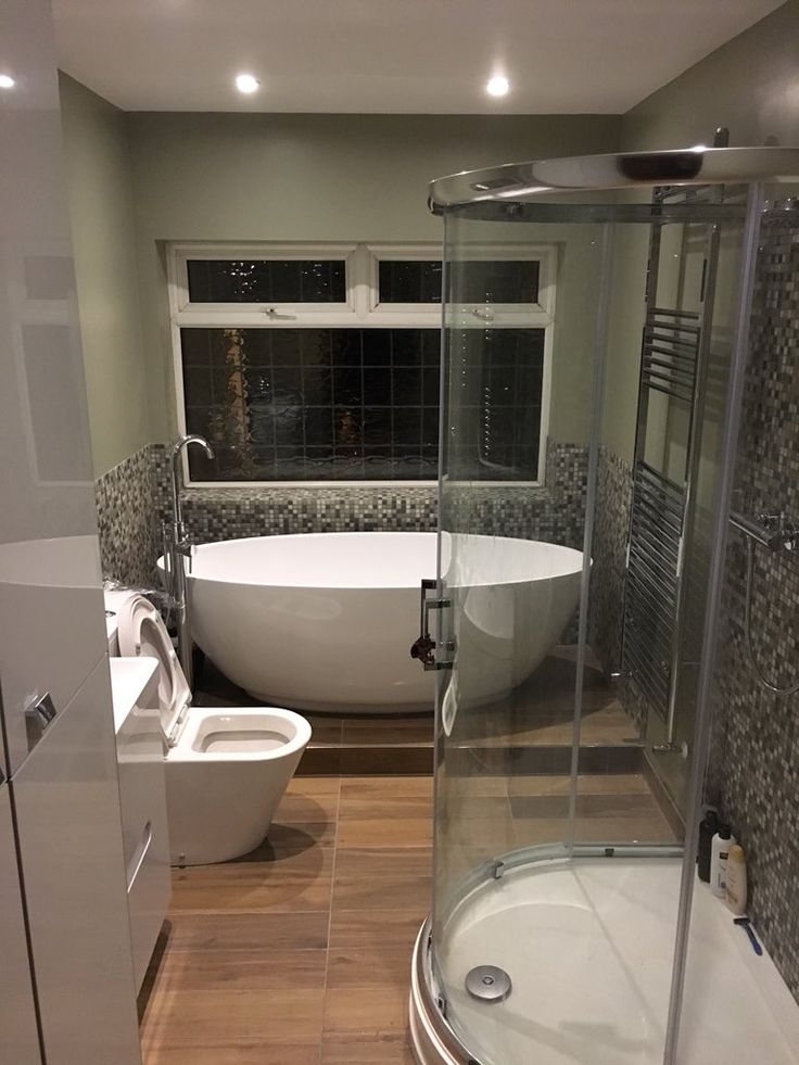 Excellent use of our Mosaic metallic tile, Such a statement back drop for the Harrison bath. We love it. #VPshareyourstyle