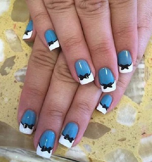 Blue and white French tip with a touch of a bow. Make your ordinary French tips stand out with adding small bows around the inner lining of the French tips.