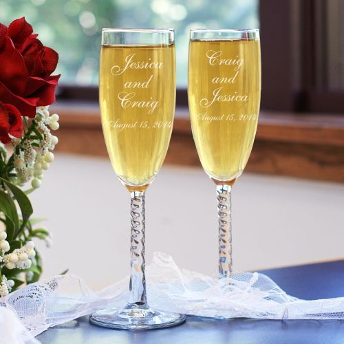 """Two souls become one on your special day. Celebrate this glorious event with this Personalized Champagne Couple Wedding Toasting Flutes and your finest bottle of bubbly. A unique & elegant personalized wedding gift they both can enjoy for years.Your Engraved Wedding Champagne Glasses are available on Angelic Twisted Stem Toasting Flutes. The Personalized Champagne Flutes feature 12 knotted twist stems and measure 8 1/4""""H. Champagne Flutes are made in the USA and hold 5.75 ounces. Per..."""
