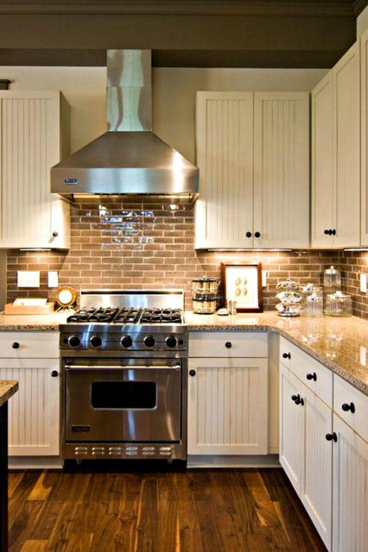 Farmhouse kitchen with brick backsplash and wood floors