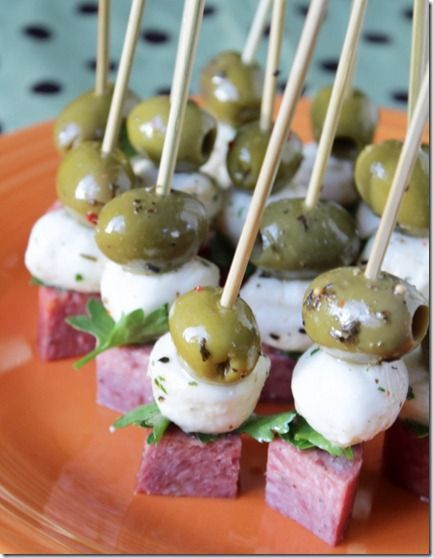Food & Drink - Food - easy appetizer - stacked marinated olive, mozzarella ball, parsley leaf & salami. Sounds like the perfect