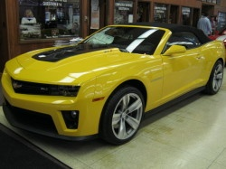 2013 Chevrolet Camaro Convertible ZL1           Vehicle In Transit This vehicle has been shipped from the assembly plant and will arrive in the near future. Please contact us for more details.  Enlarge Photo Add AccessoriesPhotos            20 moreWindow Sticker Request More Information Price  $64,450  Exterior: Gco Rally Yellow   Engine: 6.2L 8 cyl Fuel Injection   Model Code: 1EY67   Dealer Price: Contact Us   Stock Number: LD477   VIN: 2G1FZ3DP8D9804477     City (MPG)