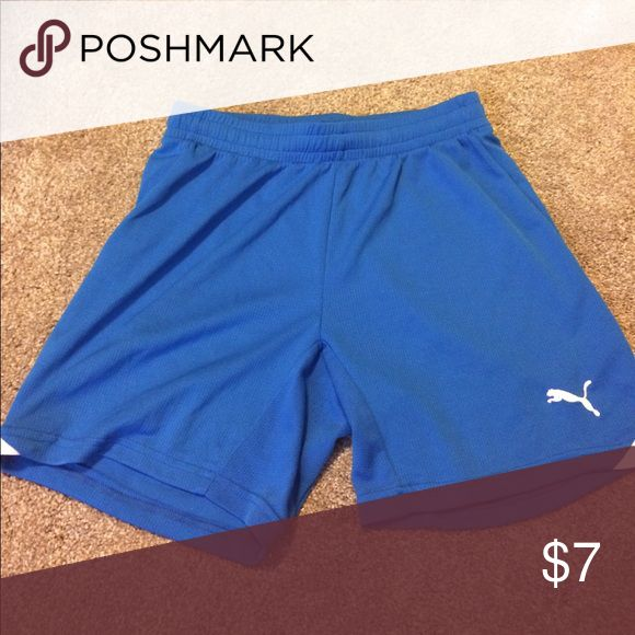 Blue puma shorts Blue and white puma shorts like new. Not size tag but I believe them to be small. Shorts