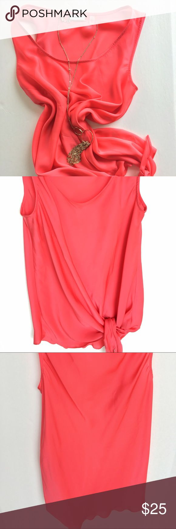 """DKNYC sleeveless blouse Classy! Gorgeous sleeveless blouse with tie on the side. Great color that pops. Like new. Shoulder to hem 27"""".  🚫 No Trades 💯% Authentic  💵 Offers welcome 💰Bundled discount 📦 Ships in 1-2 days DKNYC Tops Blouses"""