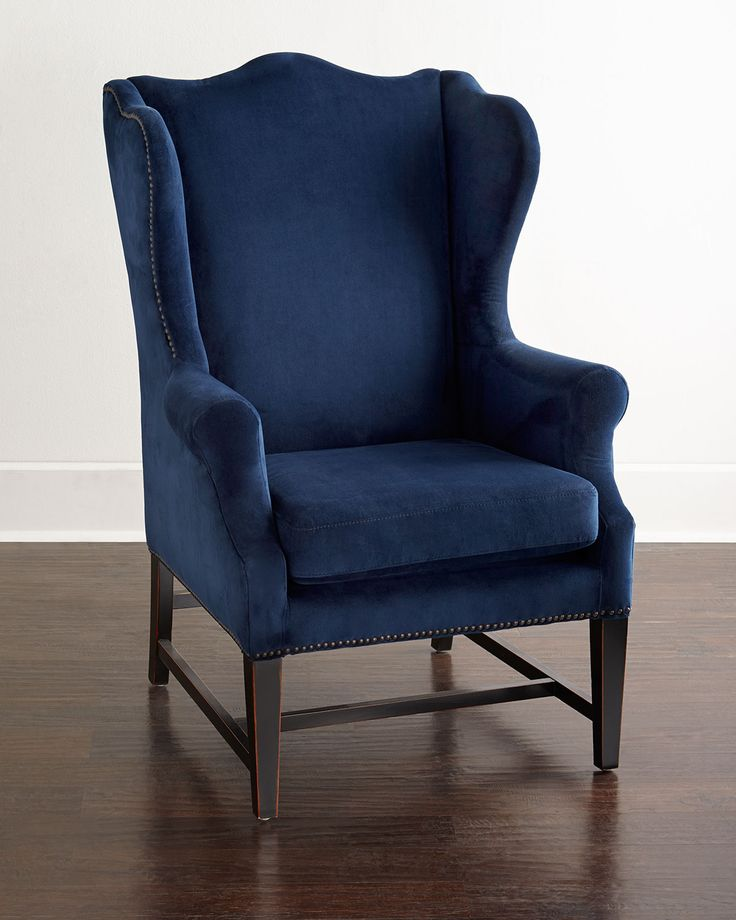 "Handcrafted wing chair. Rubberwood frame. Polyester upholstery. 31""W x 33""D x 46""T. Imported. Boxed weight, approximately 47 lbs."