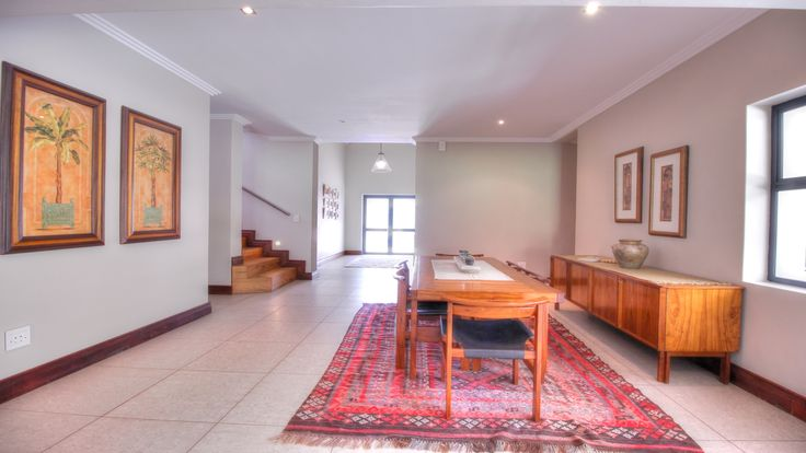 Formal dining area leading to entrance area.